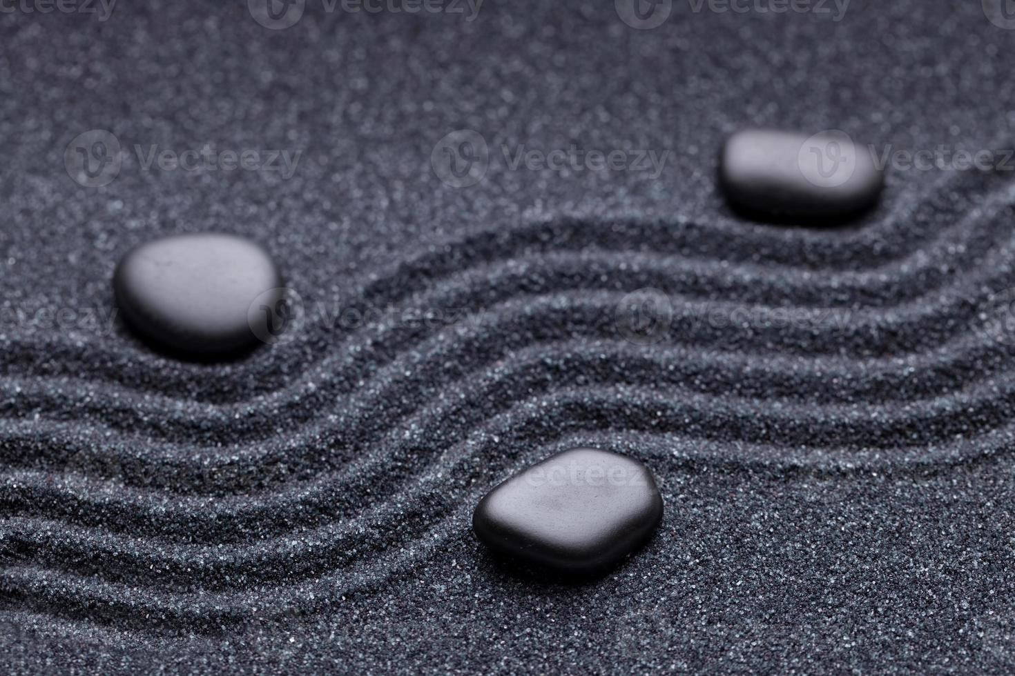 Zen garden with a wave lines in the sand photo