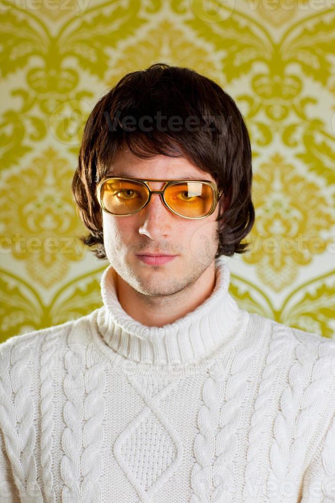 Retro male portrait in yellow shades, bowl cut, polo neck photo