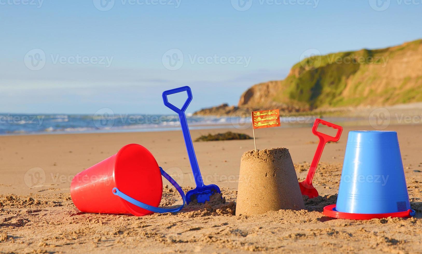 Beach, sea, buckets, spades and Welsh Flag photo