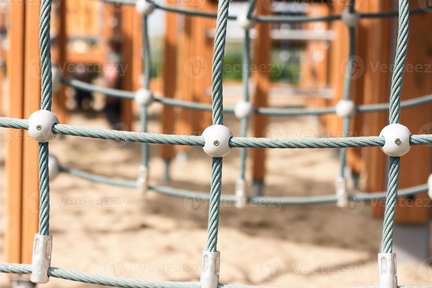 rope climbing at children playground photo