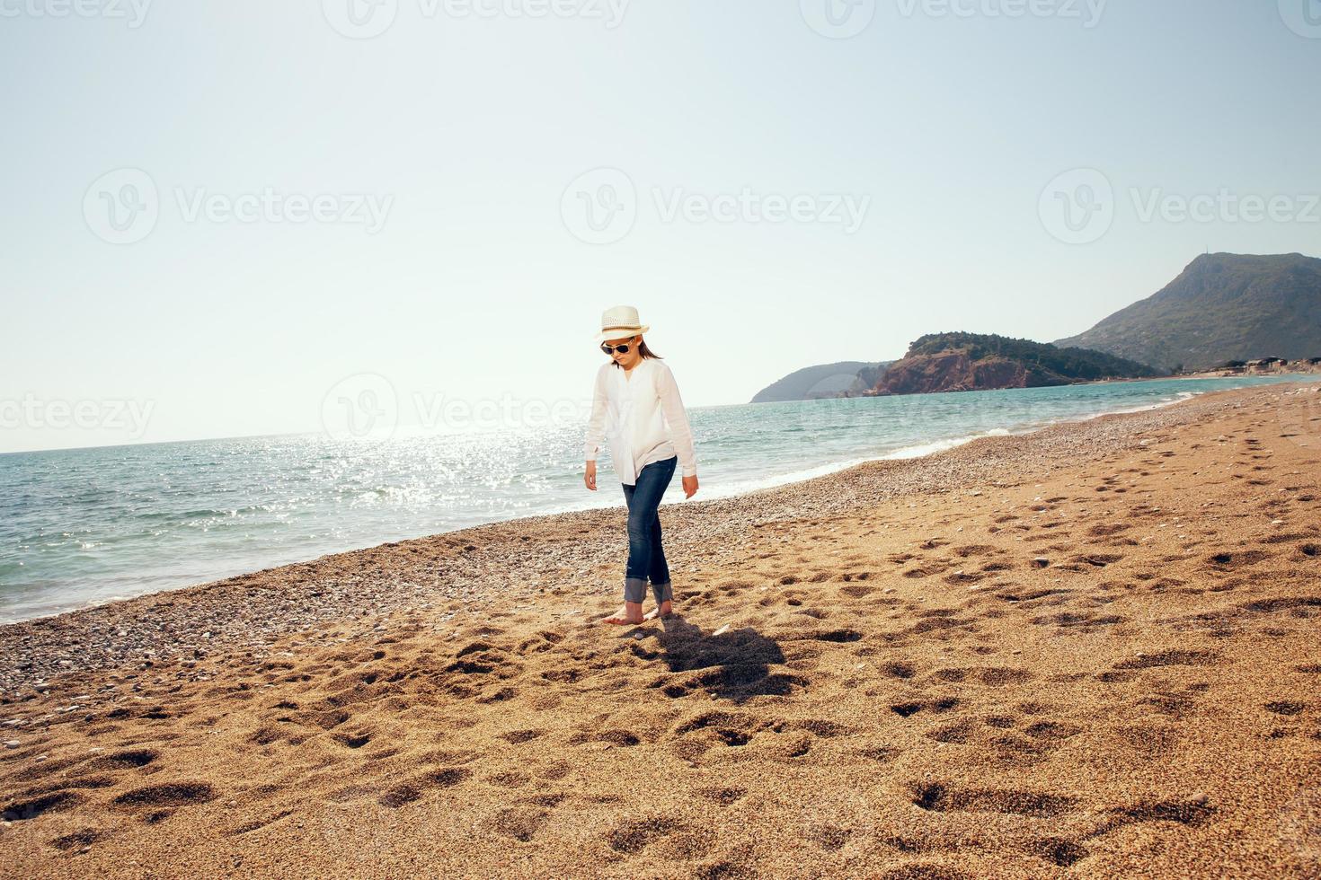 Girl walking on beach photo