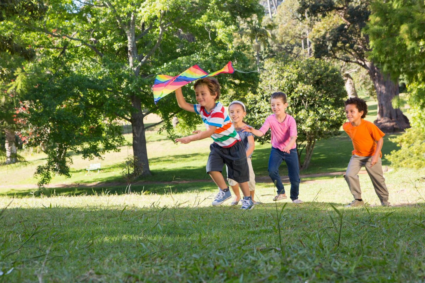 Children playing with kite in park photo