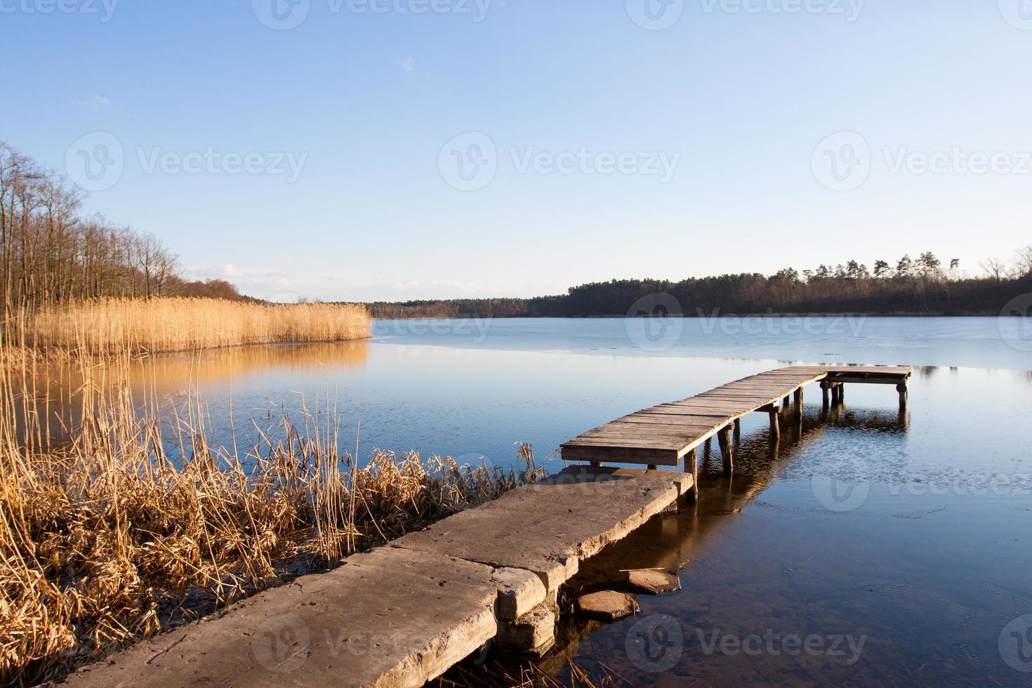 Lake in Poland slightly frozen in winter photo
