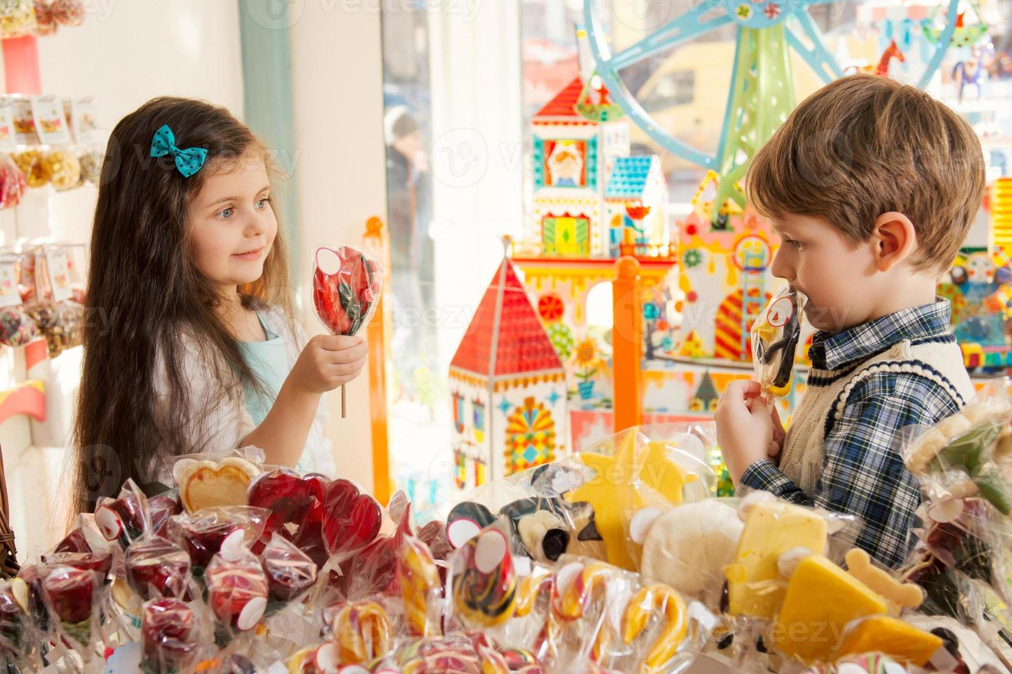 Happy children in a candy store photo