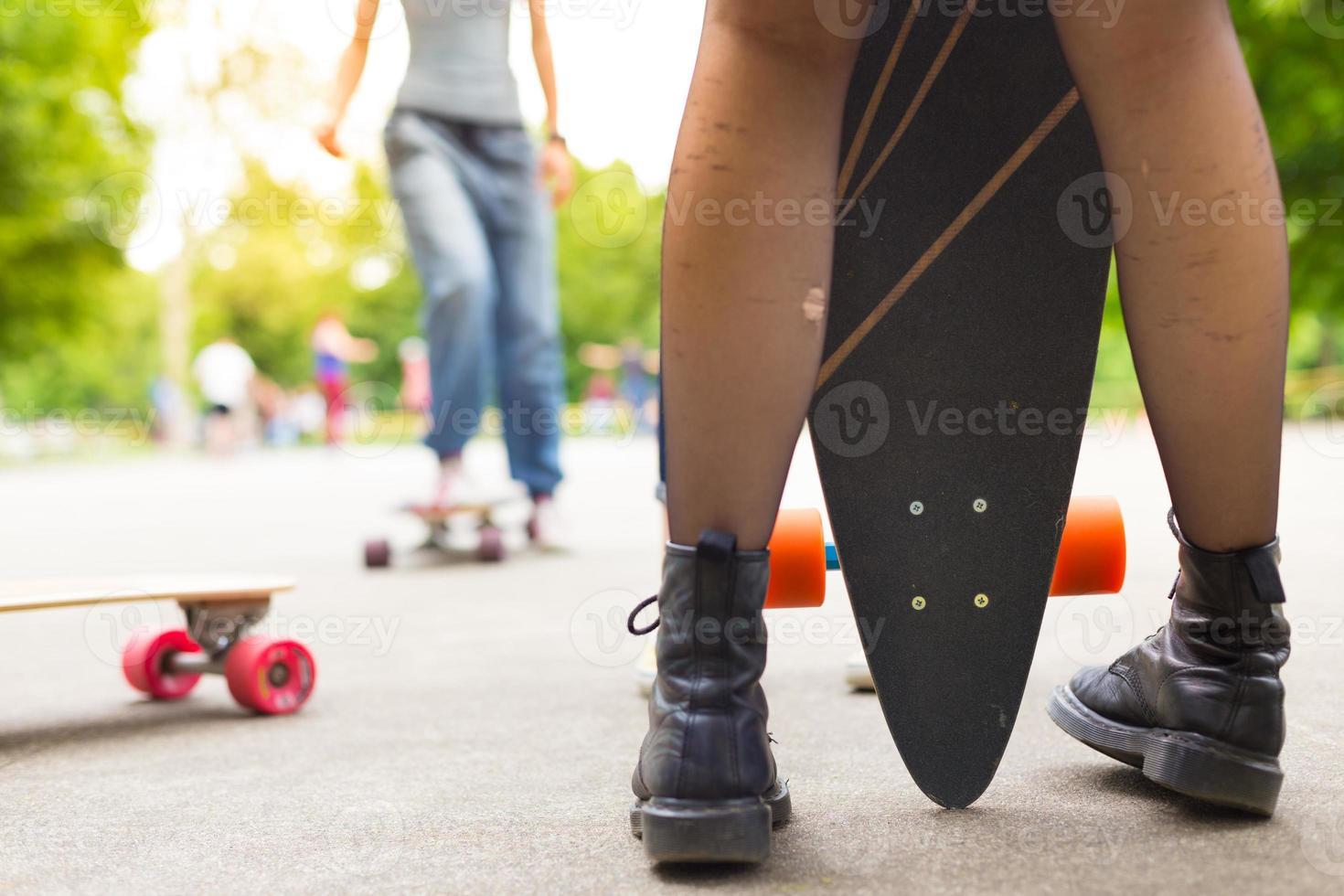 Teenage girl urban long board riding. photo