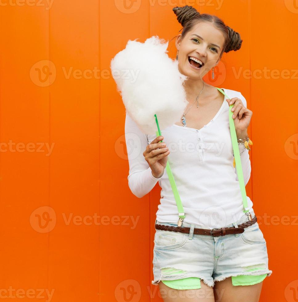 Beautiful fashionable girl with cotton candy photo