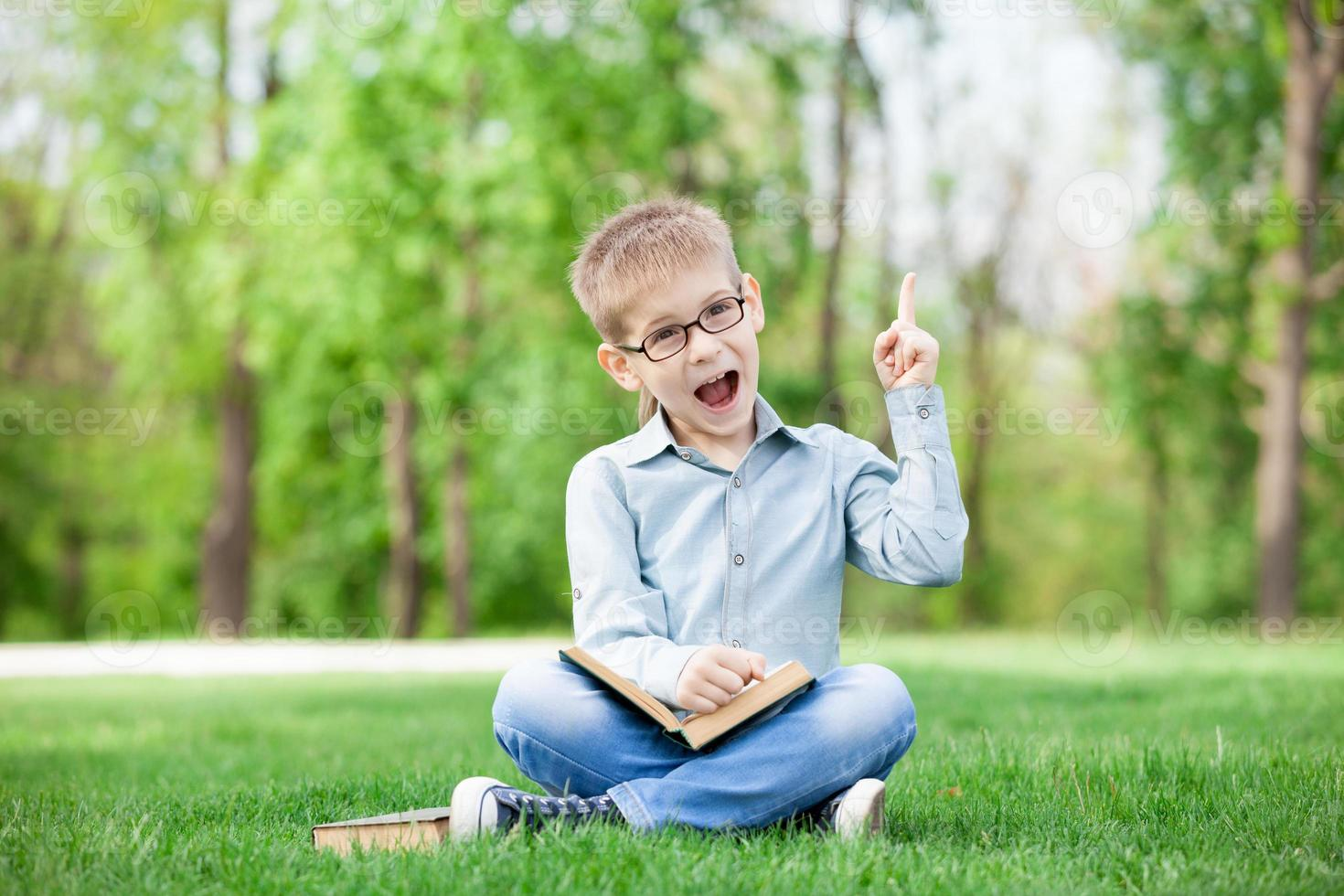 Happy young boy with a books photo