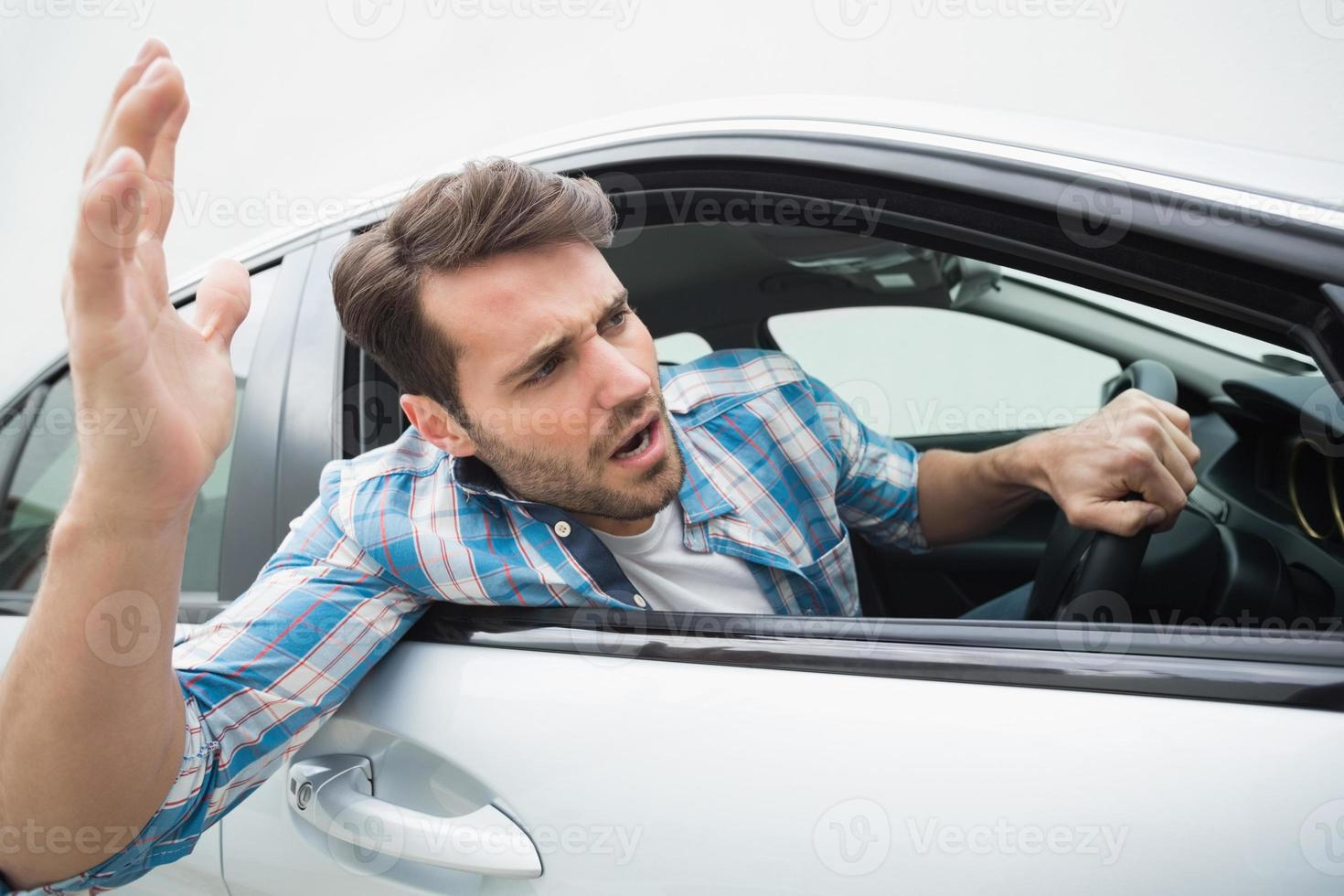 Young man experiencing road rage photo