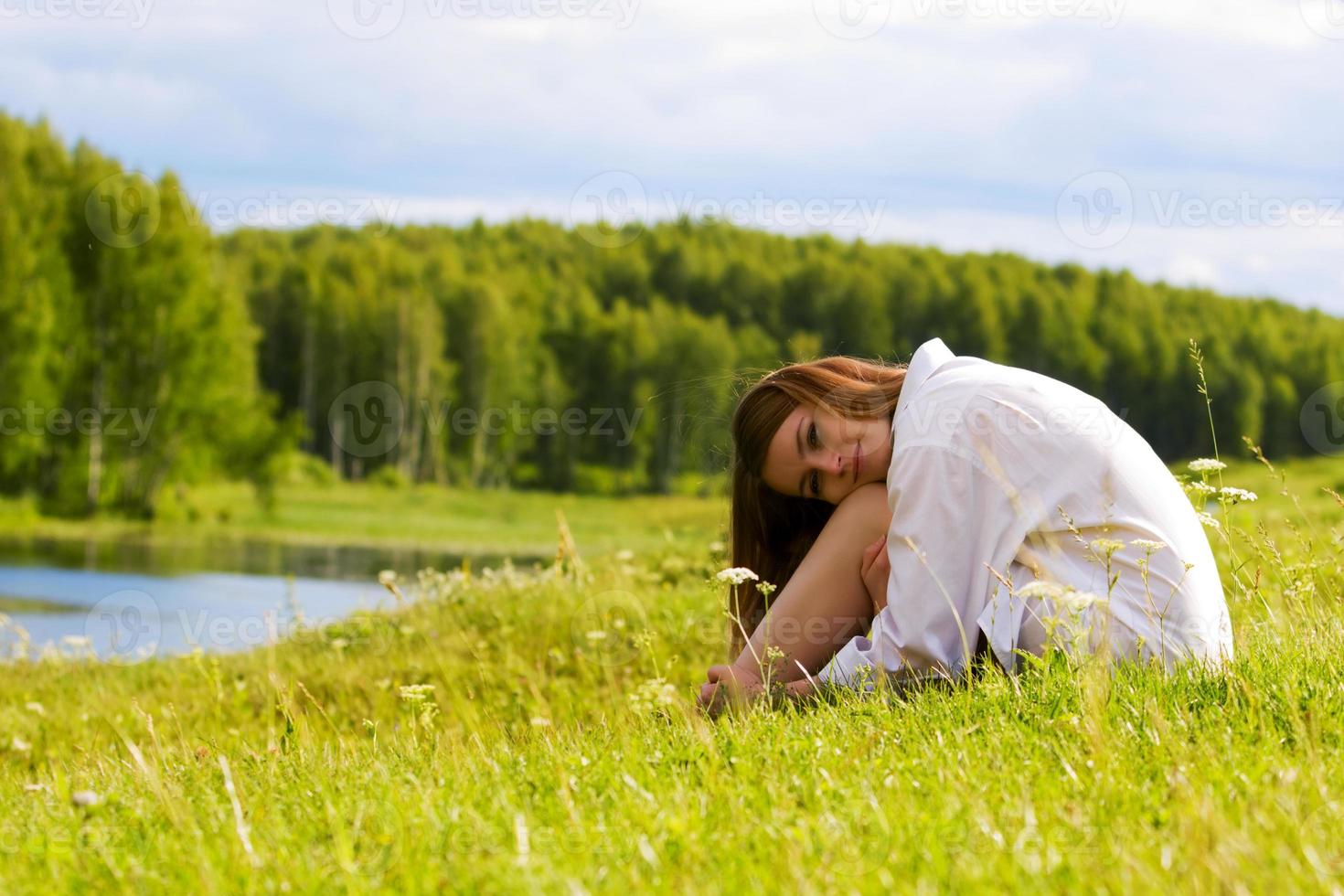 Young woman relaxing on nature photo