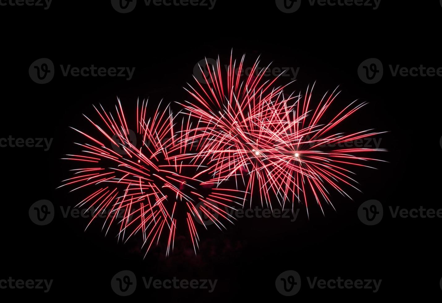 Red fireworks in the black sky photo