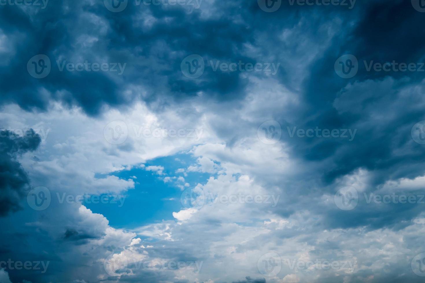 shiny blue sky in dark rainy cloud photo