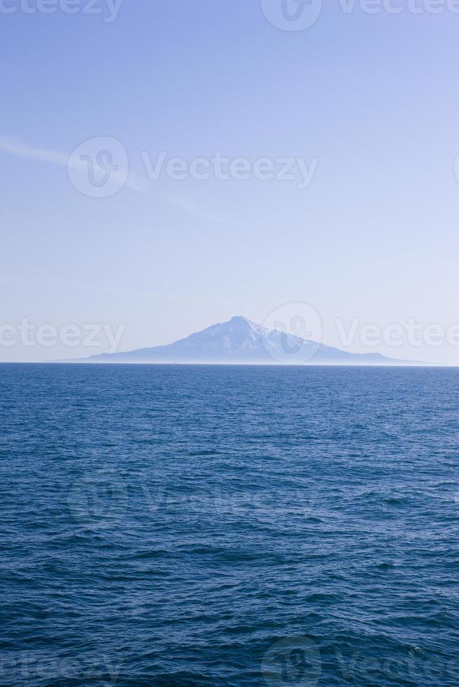 mountain which floasts in the sea photo
