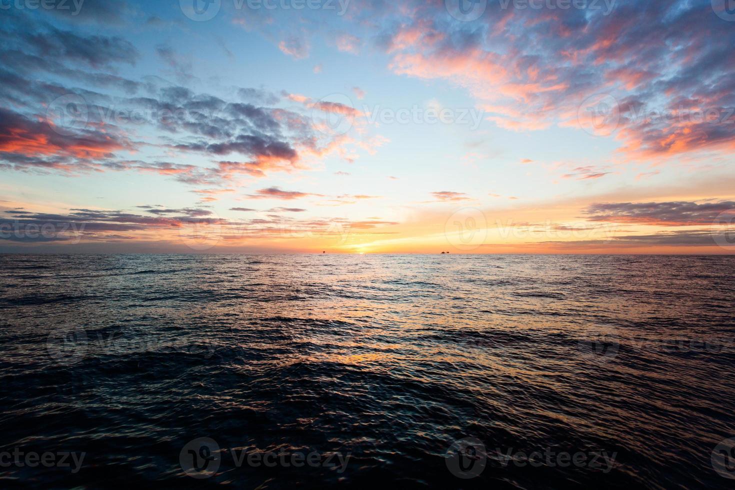 Stuning sunrise ove sea horizon photo