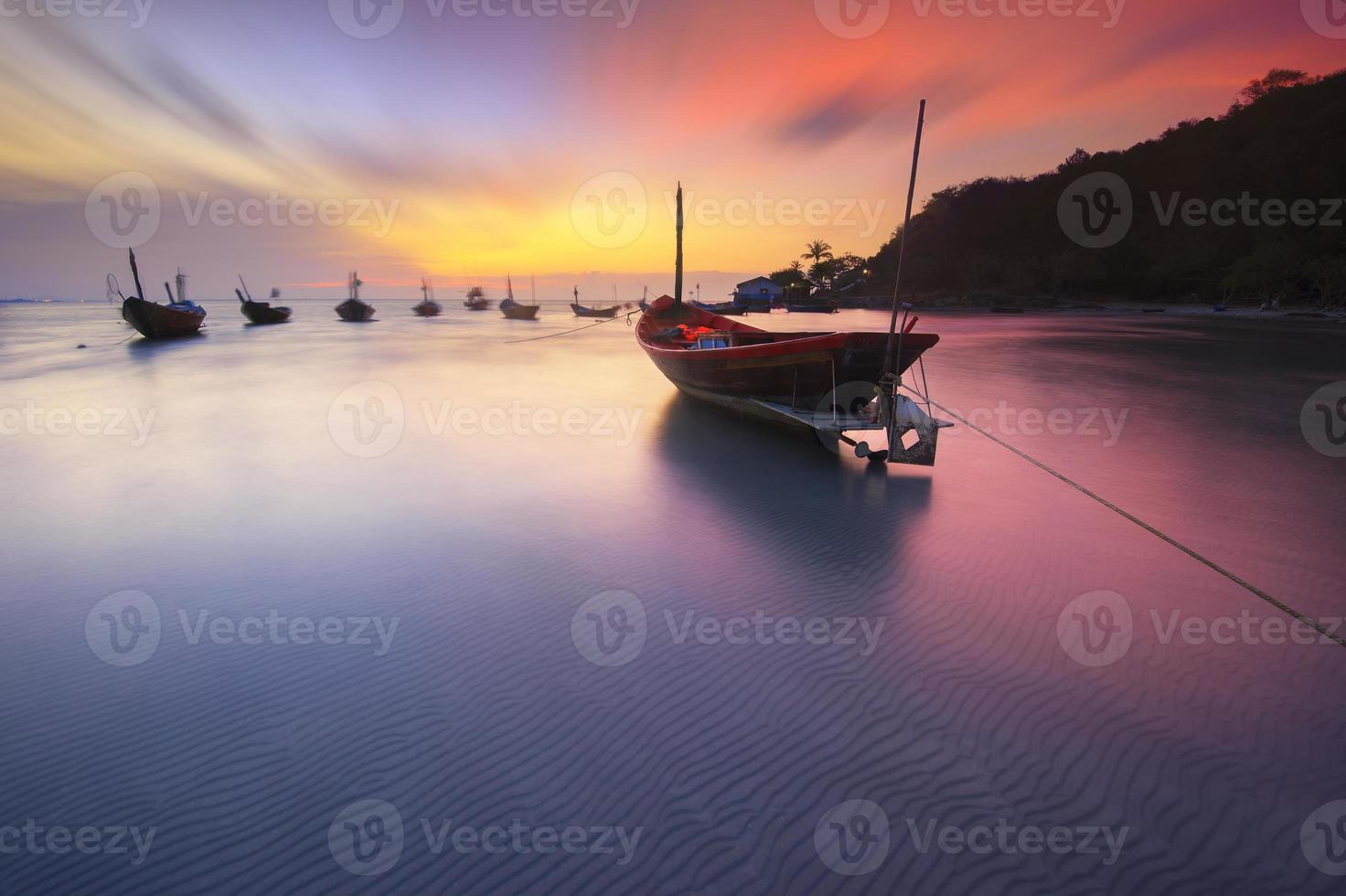 Fishing boats seaside  beach during sunset photo