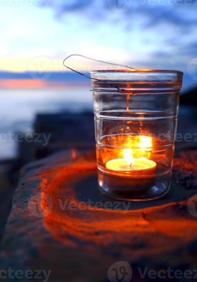 Candle in twilight photo