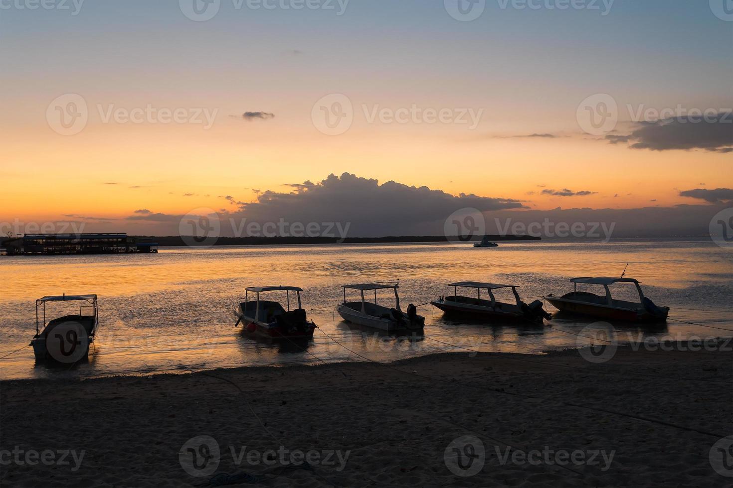 Nusa penida, Bali beach with dramatic sky and sunset photo