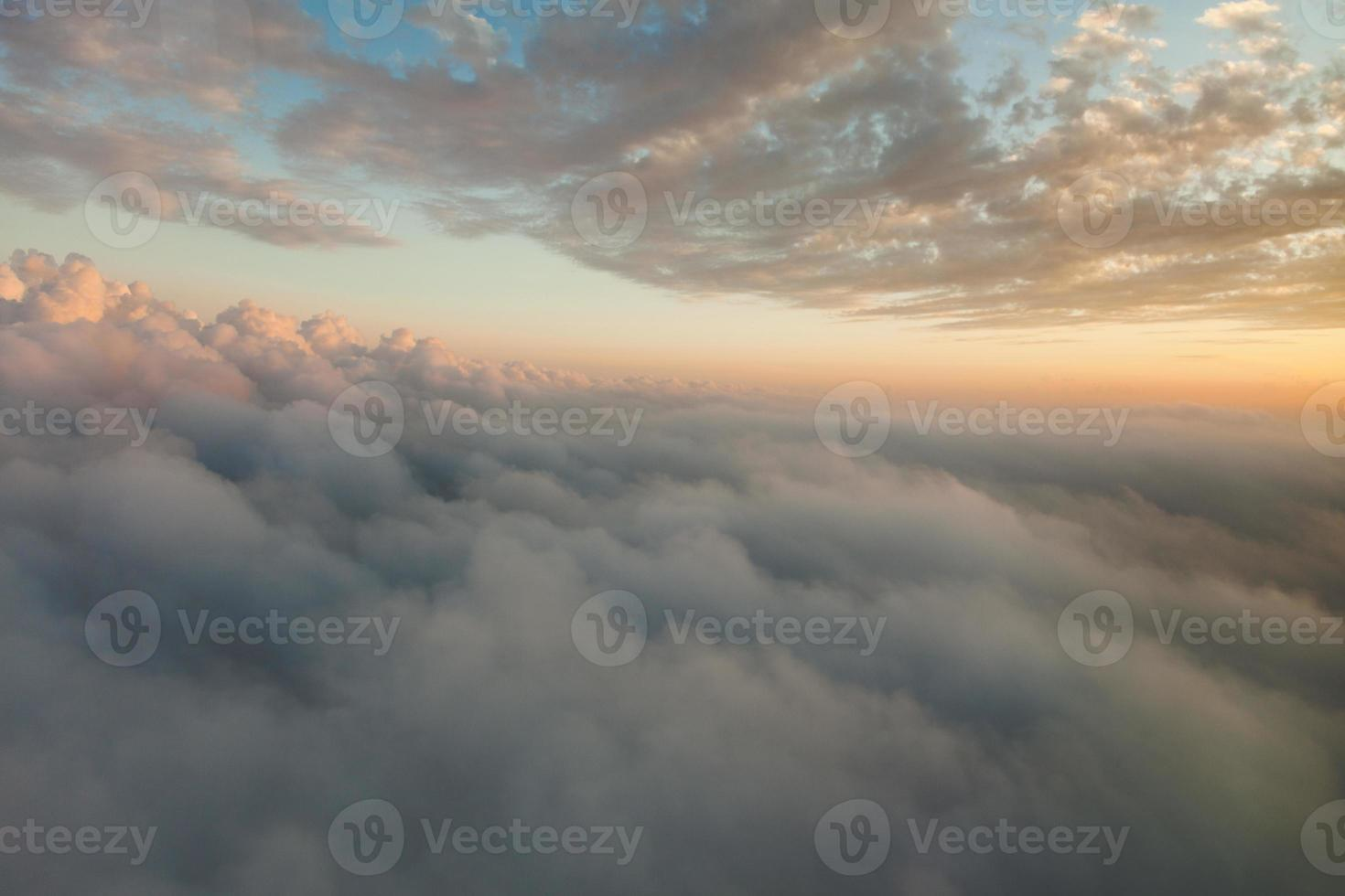 Clouds at sunset from airplane window photo