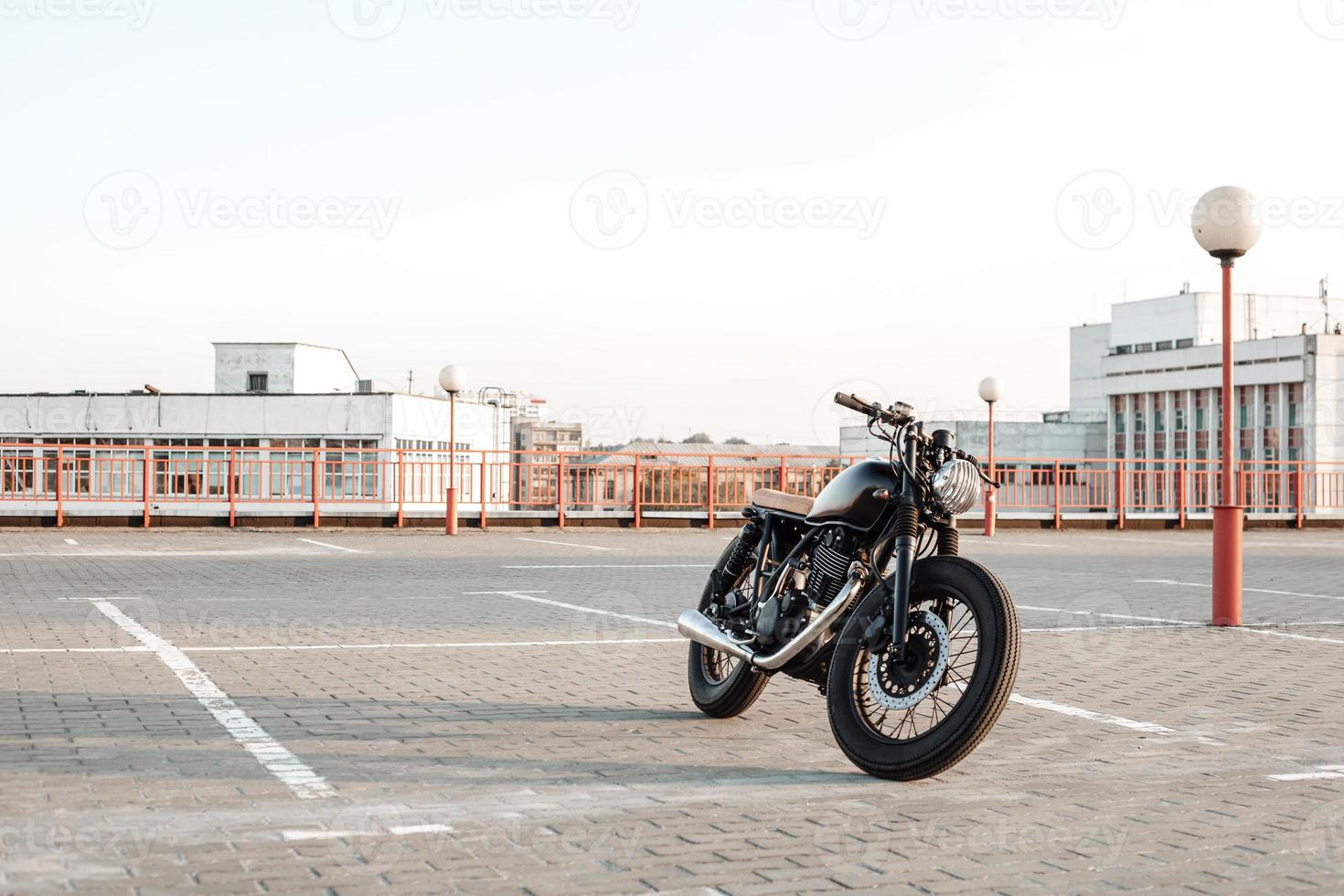 Motorbike on parking in city  with open sky on background photo