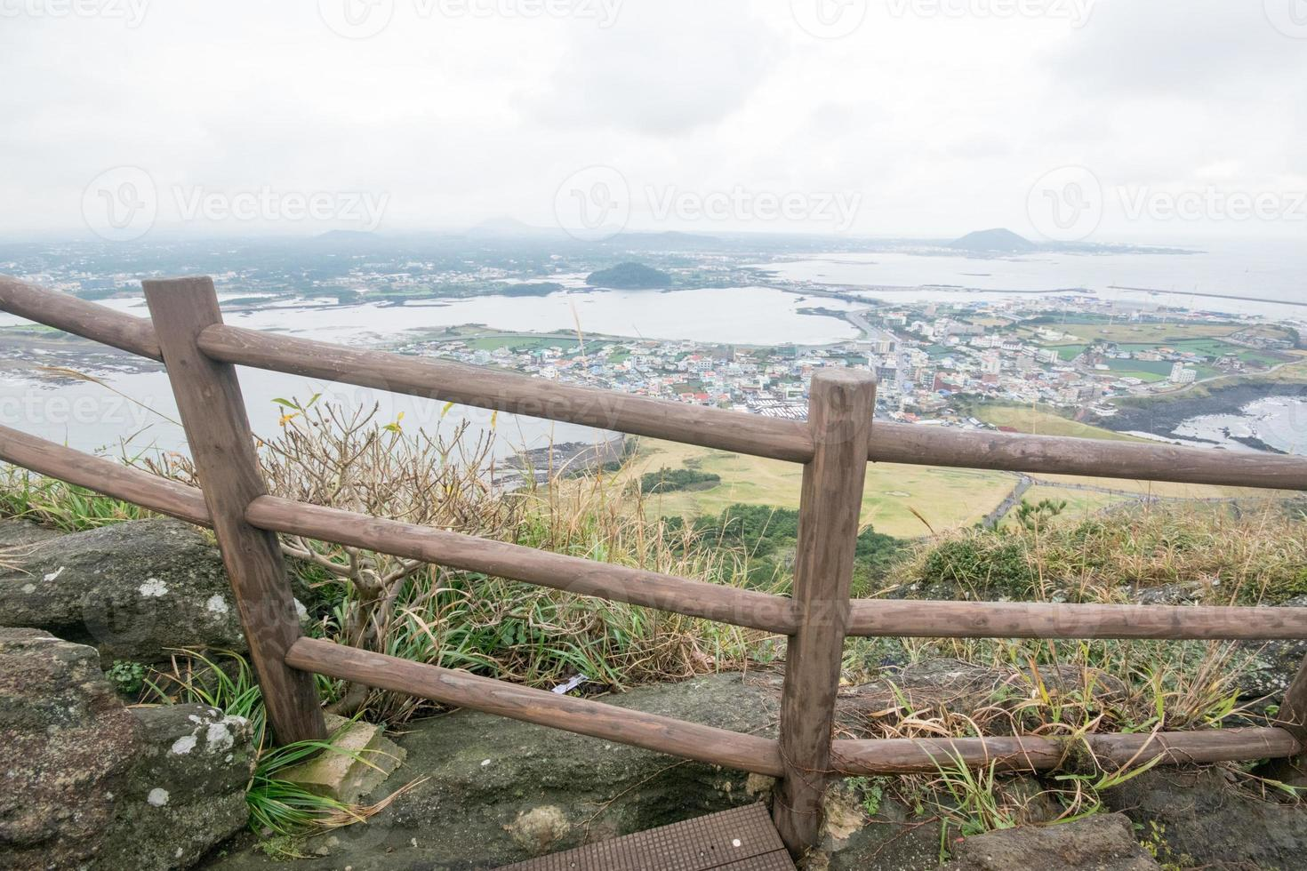 Jeju coast view with cloudy sky from Seongsan ilchubaong mountai photo