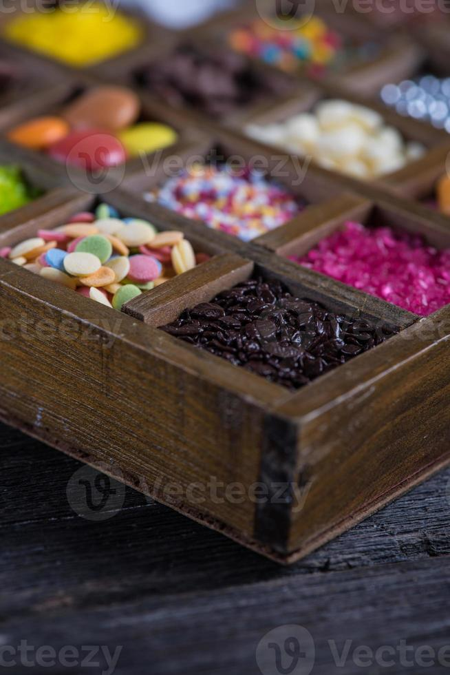 close view on sugar decoration in wooden box photo