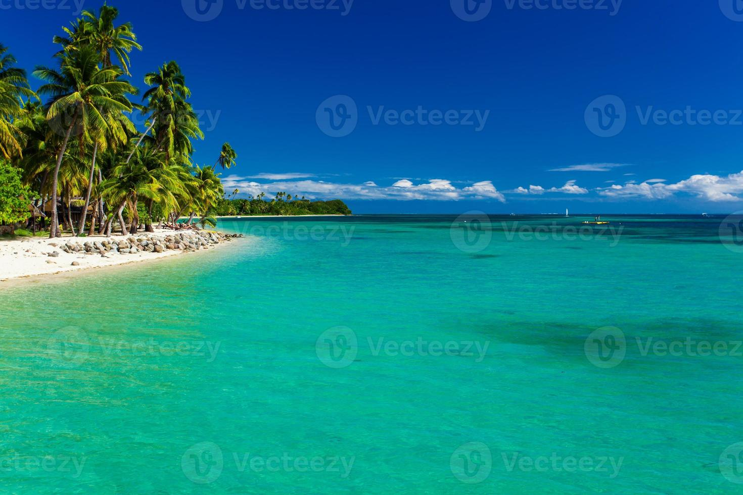 Tropical island in Fiji with sandy beach and clean water photo