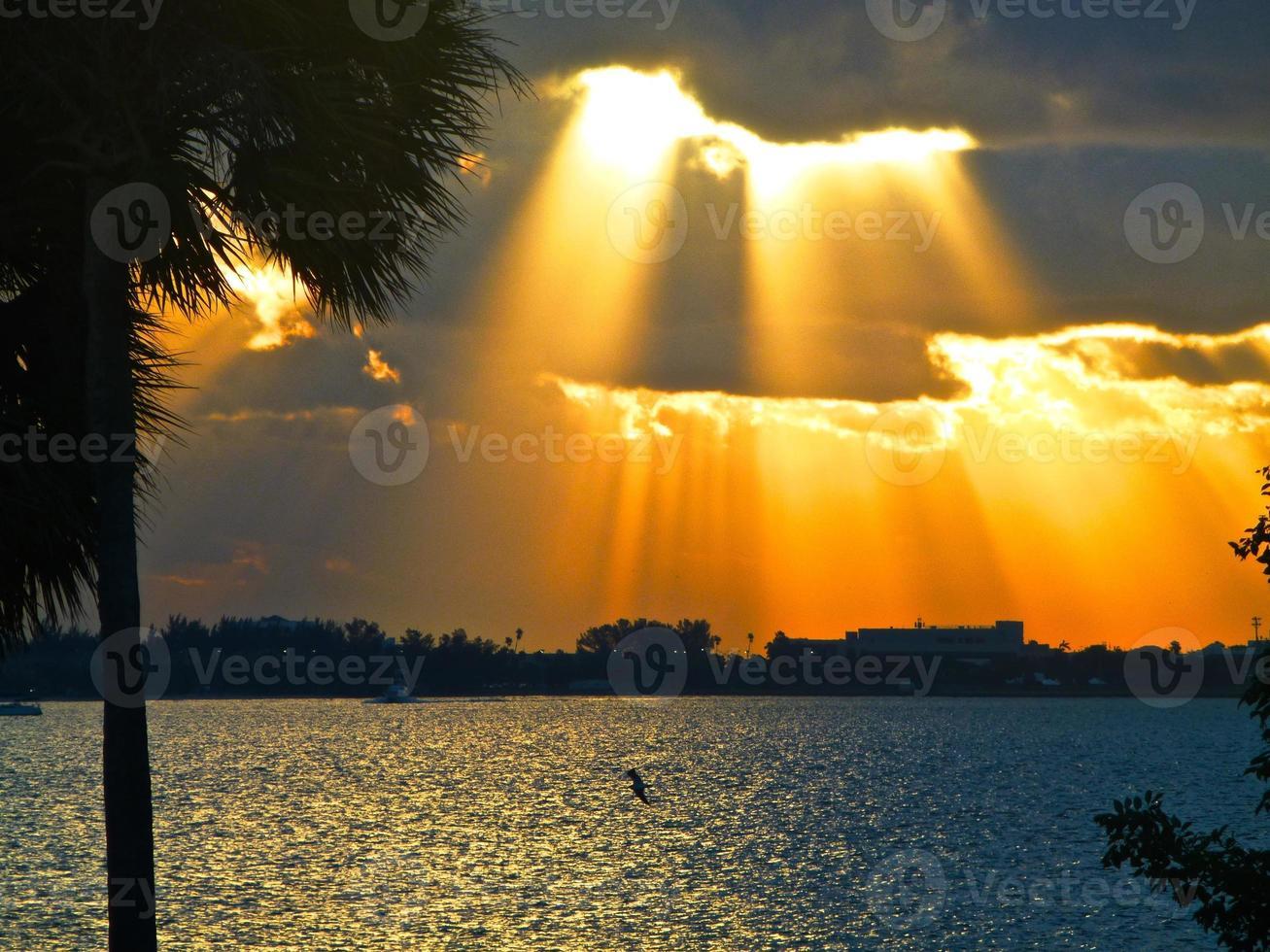 Sunrise shining thru the clouds photo