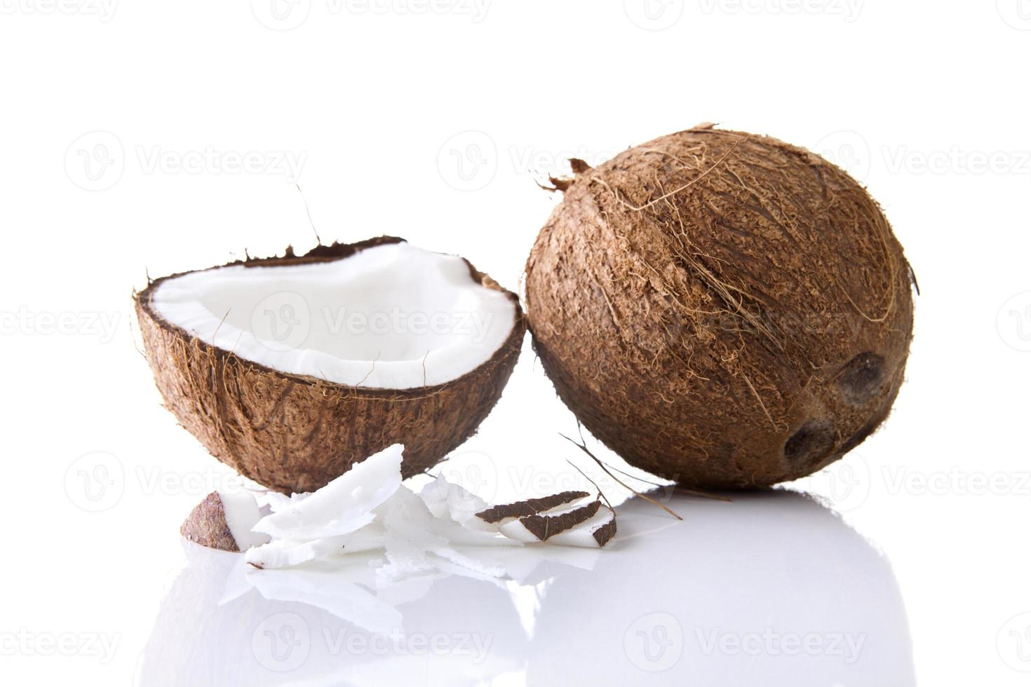 Coconuts - whole and halved photo