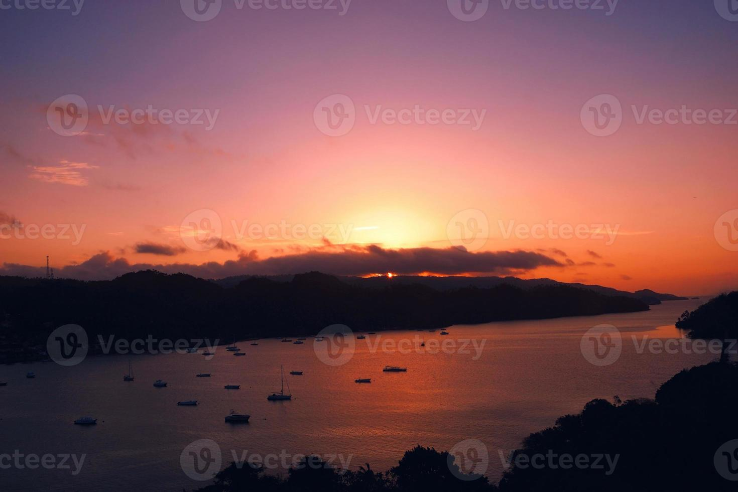 Red sunset marina boat, Samana Bay, Dominican republic photo