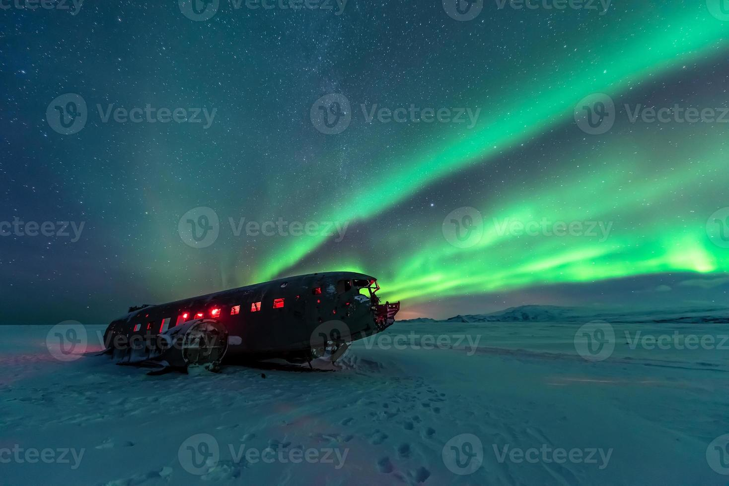 Northern lights over plane wreck photo