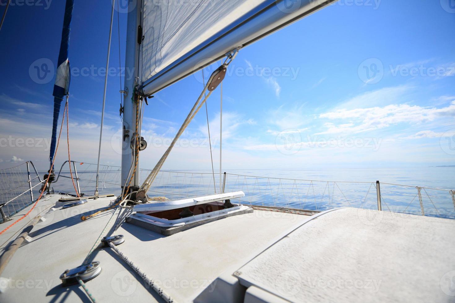Sailboat yacht sailing in blue sea. Tourism photo
