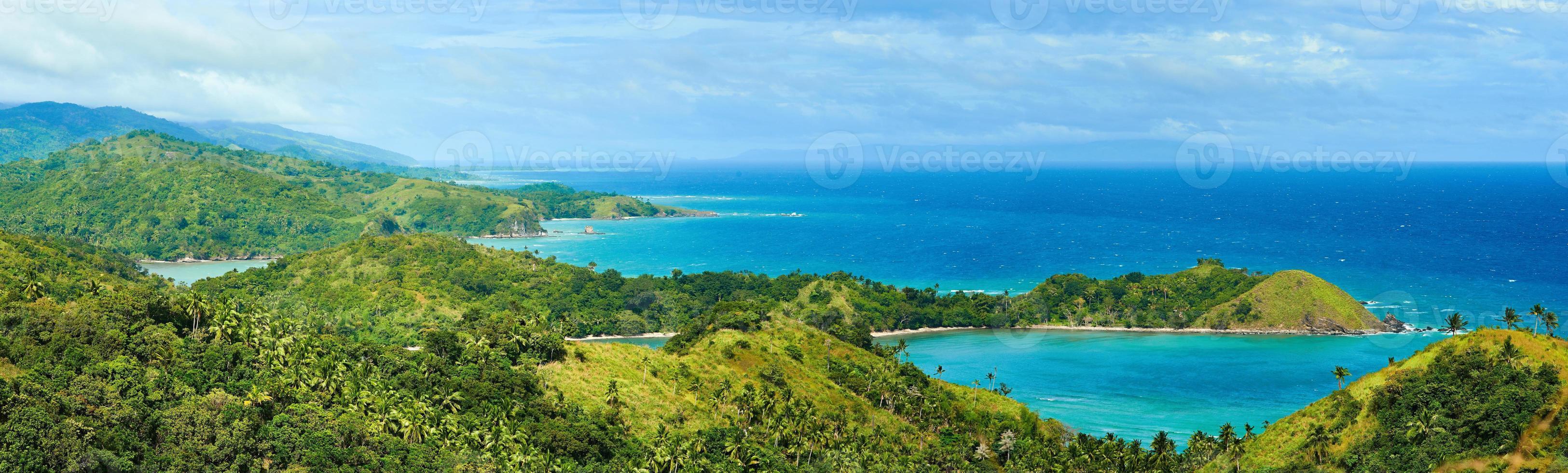 Beautiful panoramic views of coast and green mountains photo