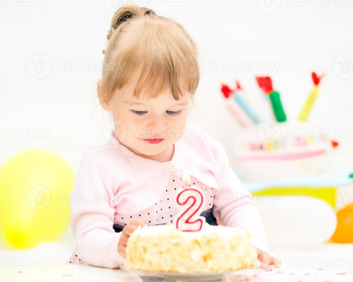 Little girl celebrating second birthday photo