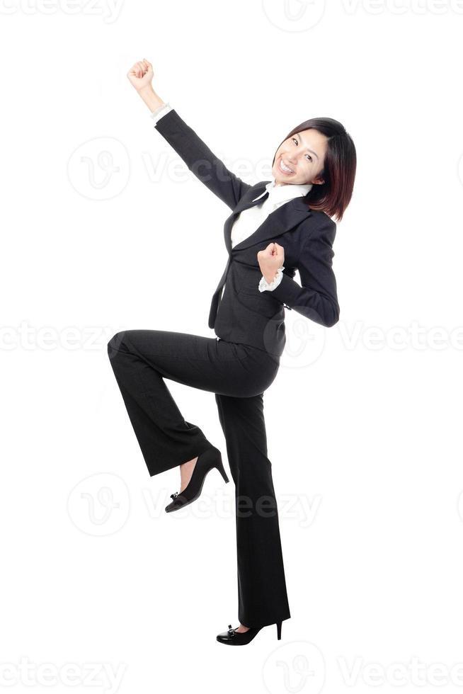 Celebrating cheering businesswoman in full length photo