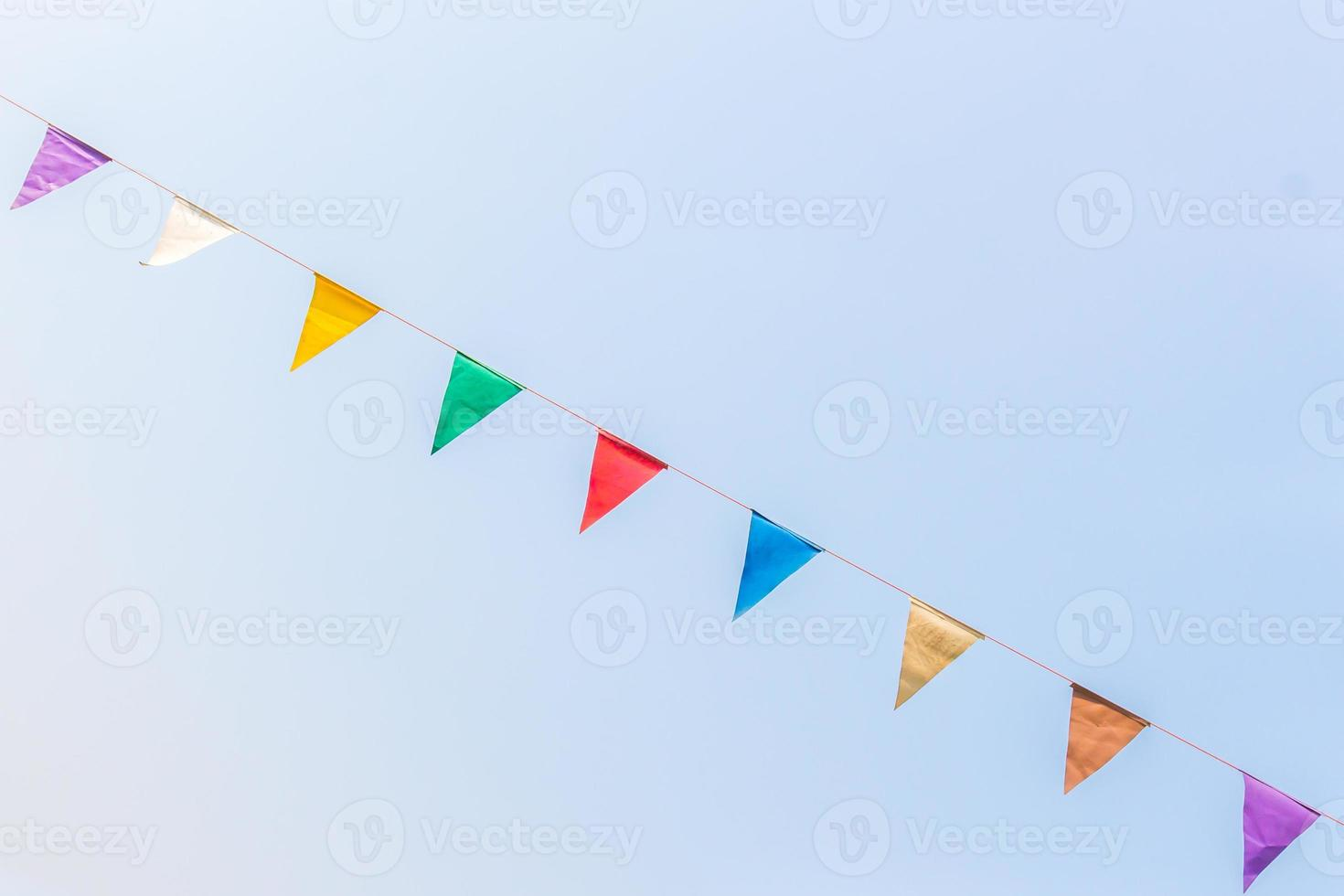 colorful festive bunting flags against. photo