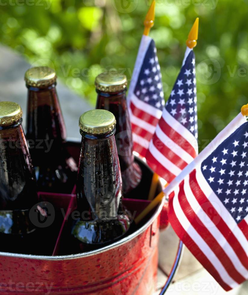 Four beers in a bucket an three American flags  photo