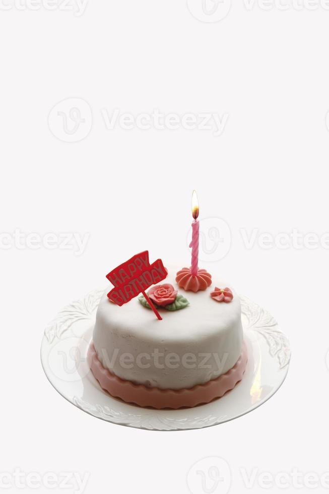 Birthday cake with burning candle photo