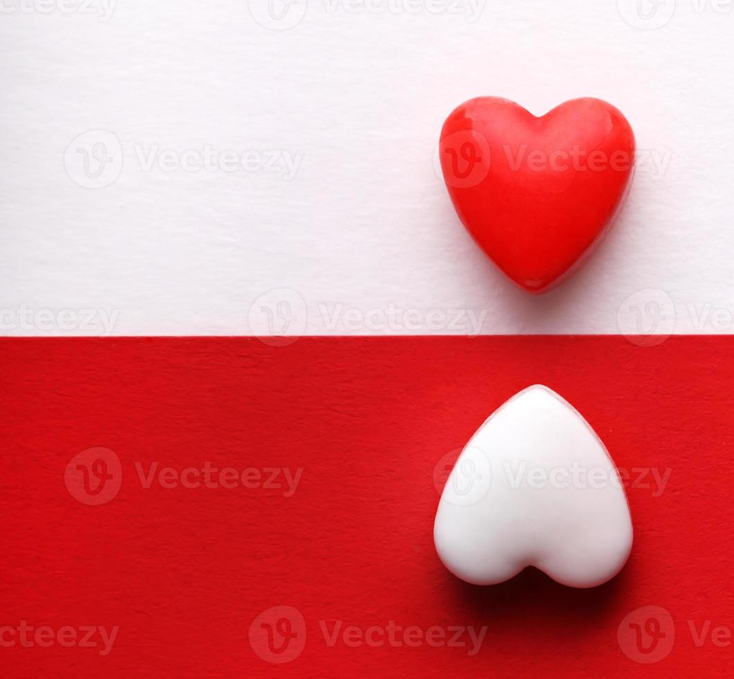 Valentine's Day Card. Two Hearts over White and Red backgrounds photo