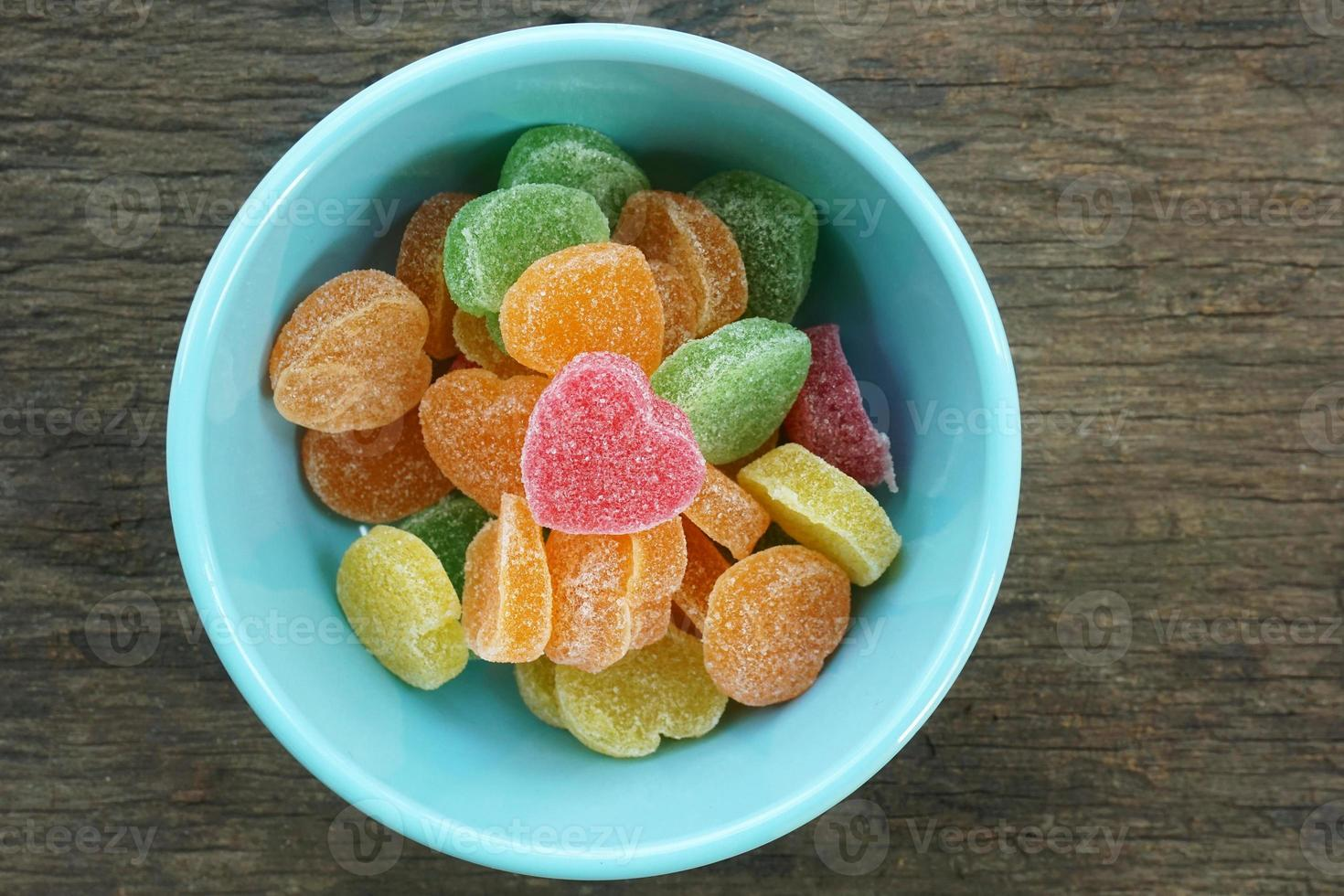 Fruit jellies candy hearts in bowl photo