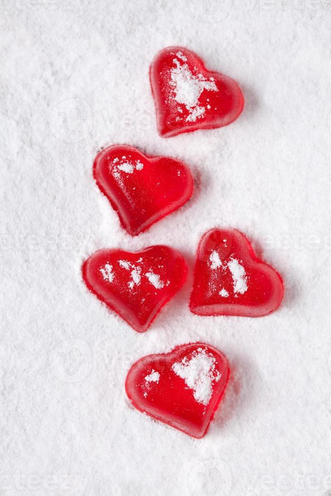 Red heart shaped jelly on powdered sugar-like snow photo
