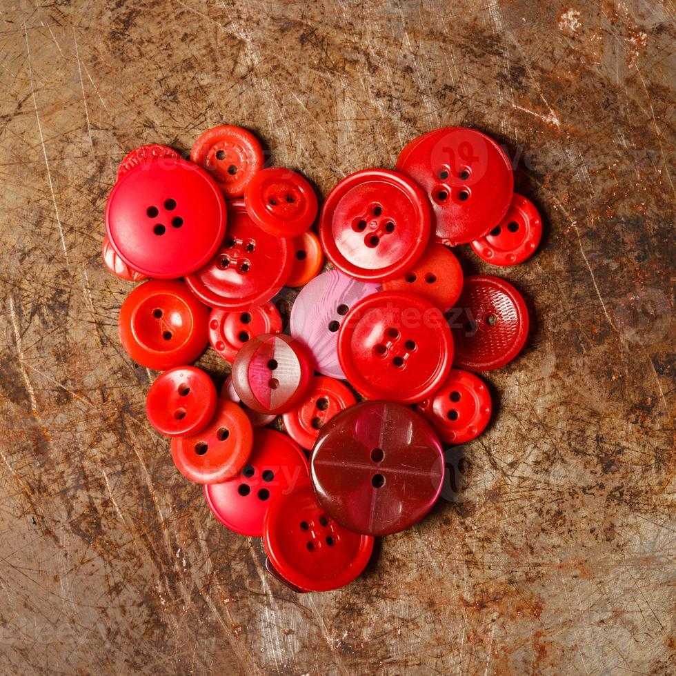 Sewing buttons heart photo