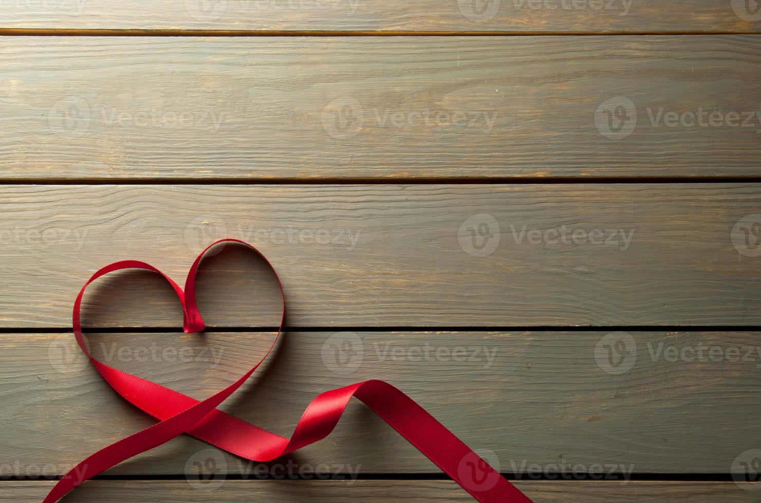 Heartshape red ribbon with space photo