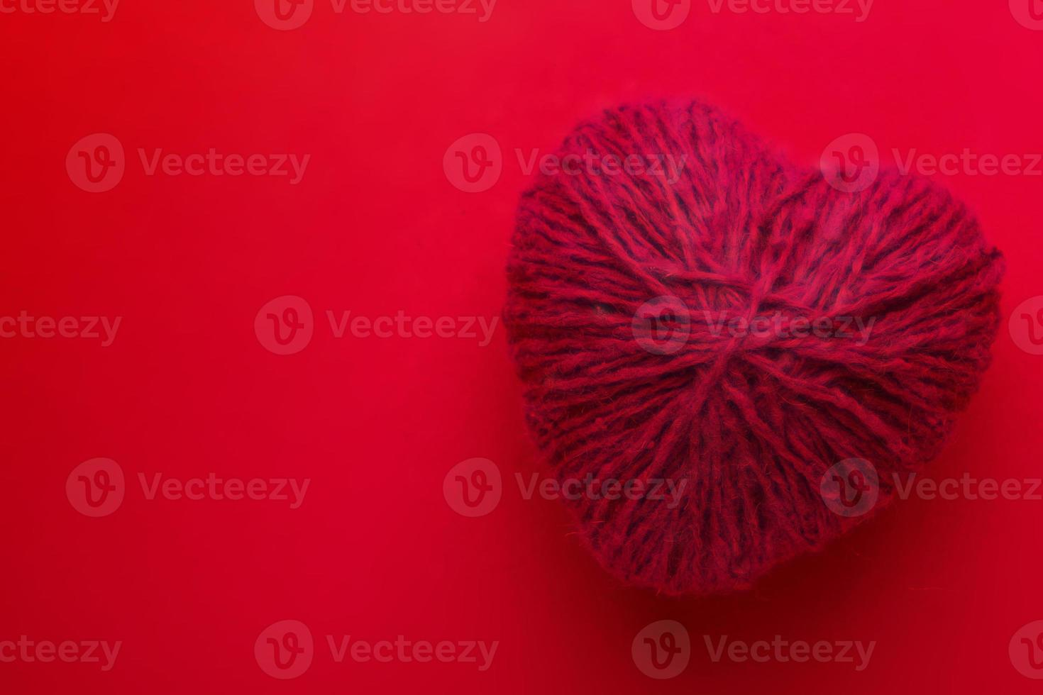 Red heart shape symbol made from wool photo