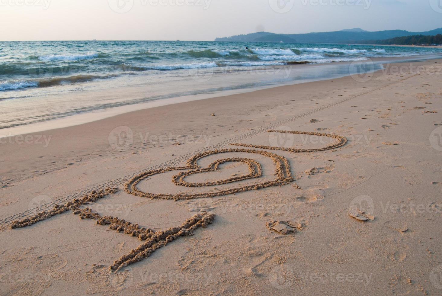 escrevendo na areia foto