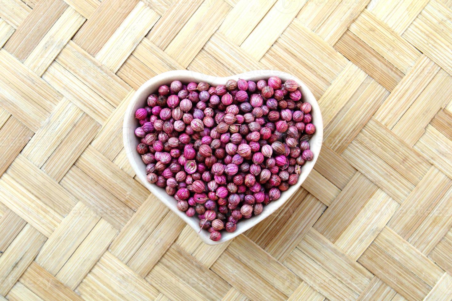 Coriander seeds in bowl heart photo