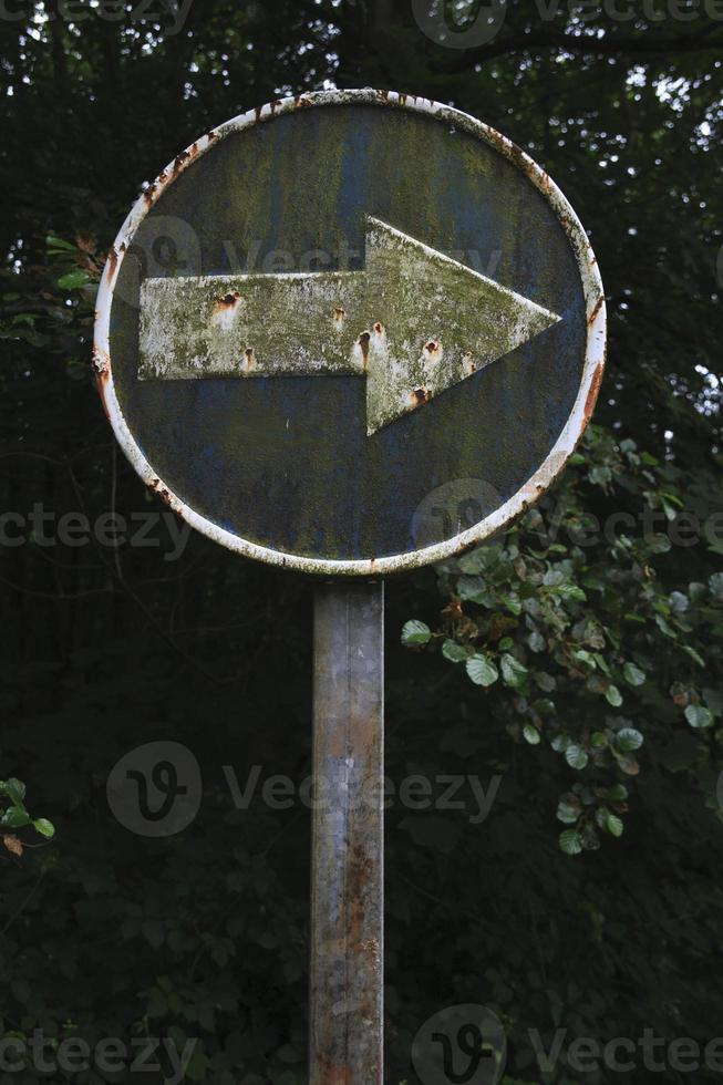 Dirty arrow, traffic sign photo