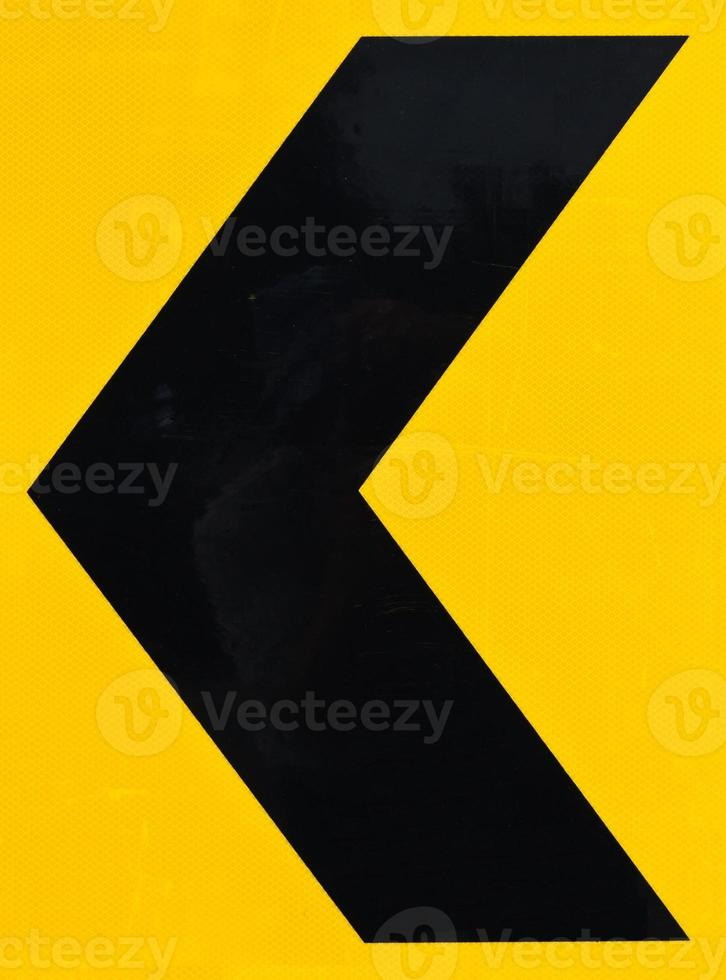 segno di avvertenza freccia nera e gialla foto