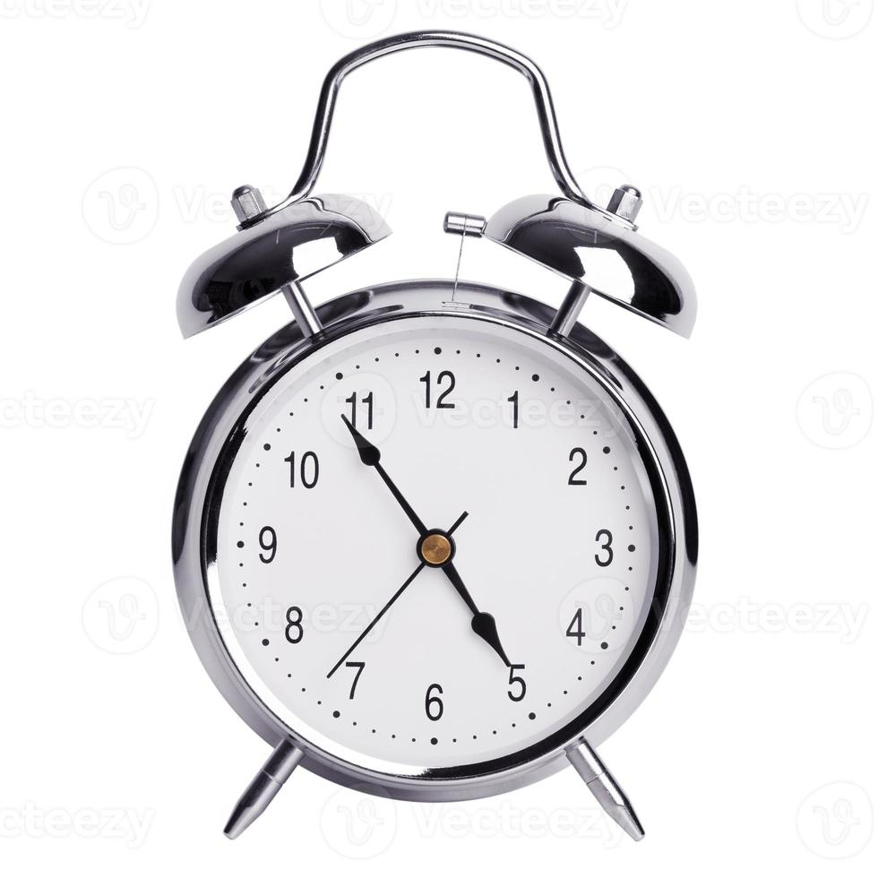 Five minutes to five on an alarm clock photo
