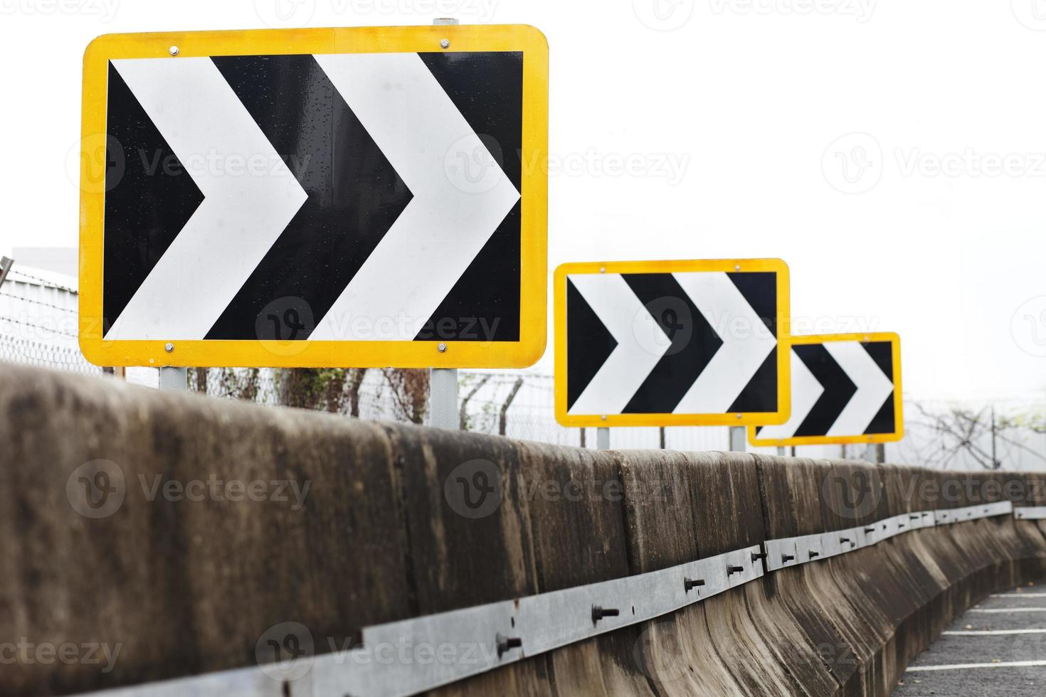 Traffic directional road signs pointing to the right photo