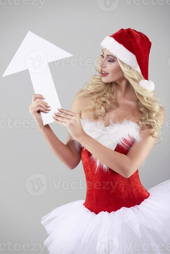 Arrow that showing the direction and Santa Claus photo