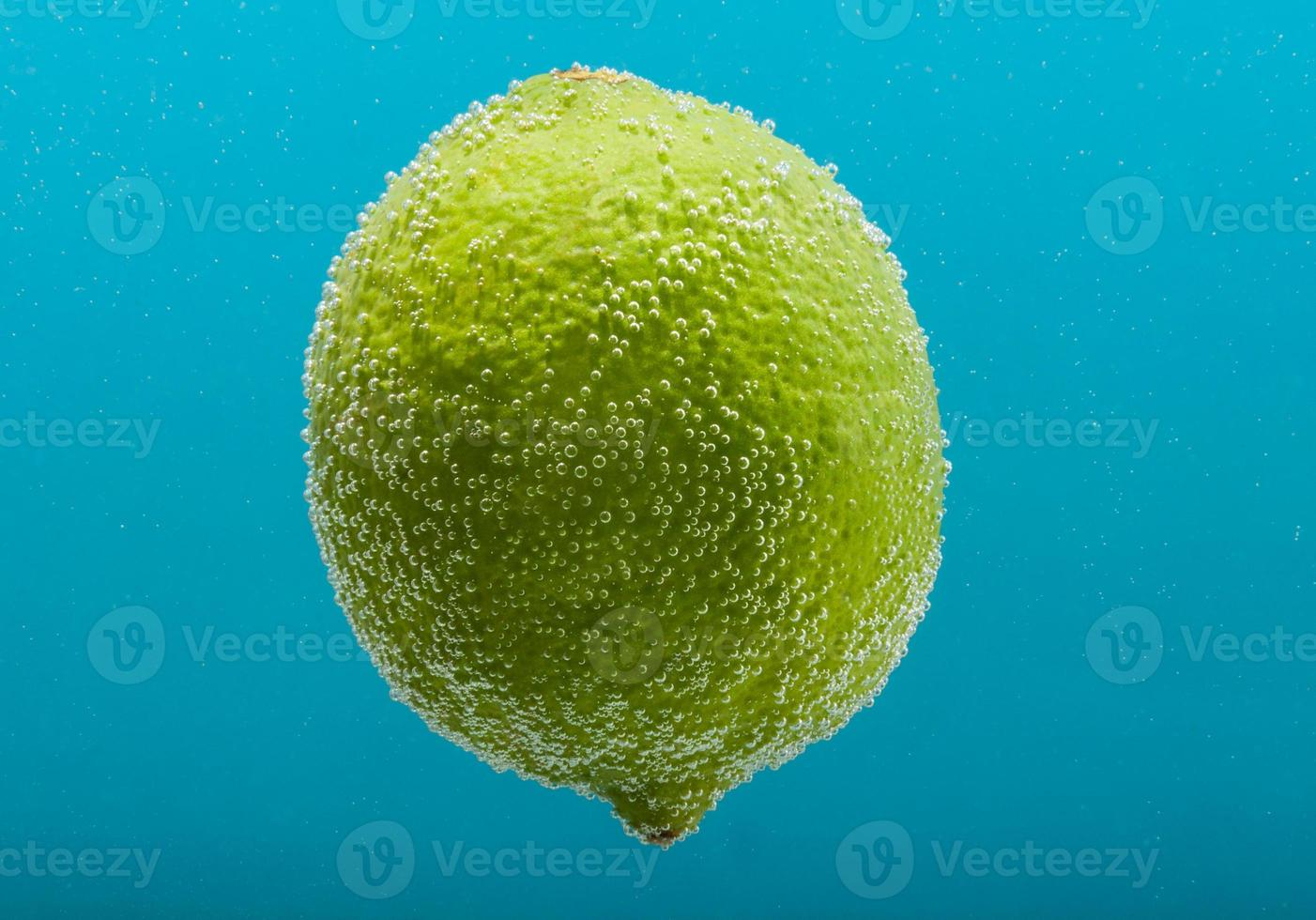 Lime in water with bubbles photo